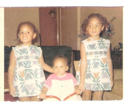 Sister # 3's First Birthday (from left): Sister #2, the Birthday Girl, and Me
